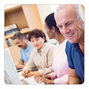 Adults looking at computer screen
